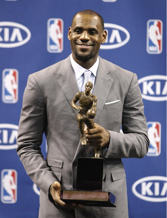 "LeBron James poses after having accepted the NBA MVP trophy, Saturday, May 12, 2012 in Miami. Calling the honor ""overwhelming"" but pointing to a ""bigger goal,"" James on Saturday became the eighth play"