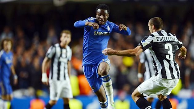 Chelsea midfielder John Mikel Obi (c) vies for the ball with Juventus' Giorgio Chiellini (R) during their UEFA Champions League Group E football match at Stamford Bridge