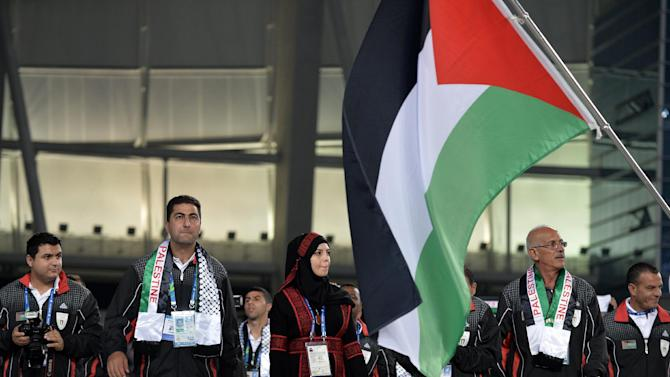 Palestinian competitors walk in the parade during the opening ceremony of the Asian Games in Incheon on September 19, 2014