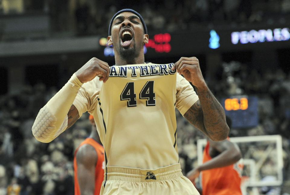 Pittsburgh's J.J. Moore celebrates their 65-55 win over Syracuse in an NCAA basketball game in Pittsburgh, Saturday, Feb. 02, 2013. (AP Photo/Joe Raymond)