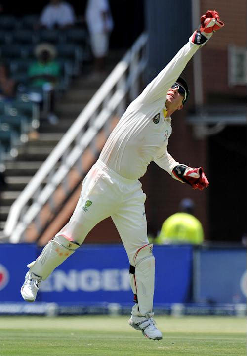 Australian wicketkeeper Brad Haddin catches the ball during the first day of the second cricket Test match between South Africa and Australia at the Wanderers Stadium in Johannesburg  on November 17,