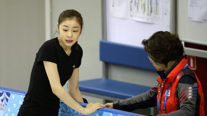 Yuna Kim of South Korea rests against the railing during a practice session at the figure skating practice rink at the 2014 Winter Olympics, Tuesday, Feb. 18, 2014, in Sochi, Russia. (AP Photo/David Goldman)