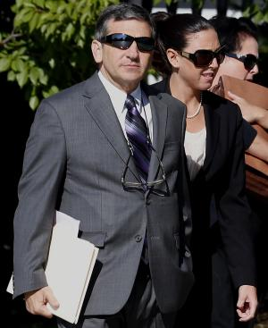 Erica DePalo, right, walks with her attorney Anthony Alfano into Essex County Superior Court before an appearance, Wednesday, Sept. 12, 2012, in Newark, N.J. DePalo, the 2011 Essex County teacher of the year, pled not guilty to charges she had a sexual relationship with a 15-year-old honors student. Prosecutors say the 33-year-old Montclair resident had a relationship with a boy in her honors English class. They say the affair started in June and ended recently. DePalo has been indefinitely suspended from her job teaching English at West Orange High School. (AP Photo/Julio Cortez)