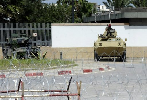 Tunisian soldiers guard the US embassy building in the capital Tunis on September 15. A senior member of Tunisian hardline Salafist group Ansar al-Sharia has been arrested in connection with the attack on the US embassy in Tunis earlier this month