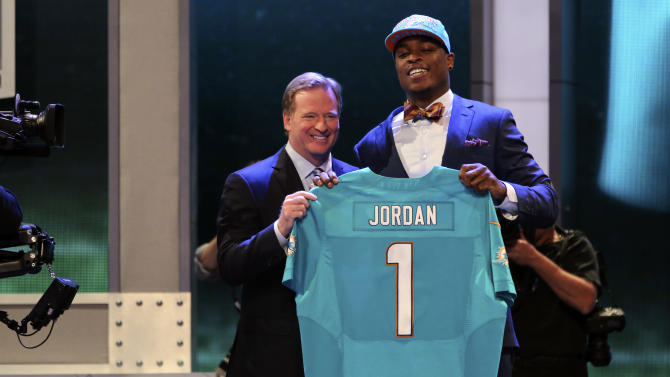 Dion Jordan, a defensive end from Oregon, stands with NFL Commissioner Roger Goodell after being selected third overall by the Miami Dolphins in the first round of the NFL football draft, Thursday, April 25, 2013, at Radio City Music Hall in New York. (AP Photo/Mary Altaffer)