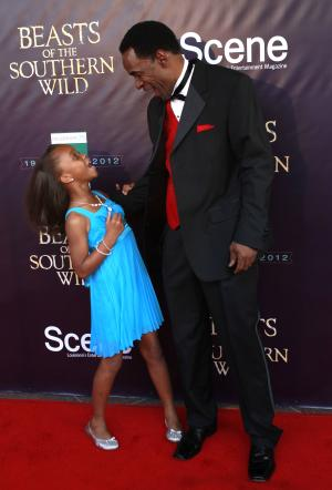 "Actress Quvenzhané Wallis and actor Dwight Henry arrive at the movie premiere of ""Beasts Of The Southern Wild"" at the Joy Theater in New Orleans, Monday, June 25, 2012. (AP Photo/Gerald Herbert)"