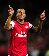 Arsenal&#39;s Theo Walcott celebrates scoring against Coventry