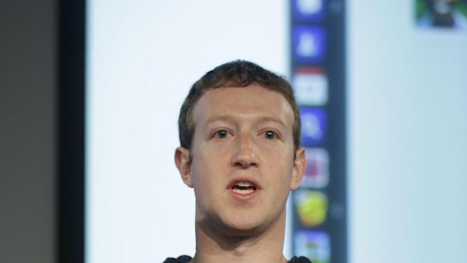 Facebook CEO Mark Zuckerberg speaks at Facebook headquarters in Menlo Park, Calif., Thursday, March 7, 2013. Zuckerberg on Thursday unveiled a new look for the social network's News Feed, the place where its 1 billion users congregate to see what's happening with their friends, family and favorite businesses. (AP Photo/Jeff Chiu)