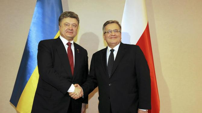 Polish President Komorowski shakes hands with Ukrainian President Poroshenko during their meeting in a hotel in Krakow