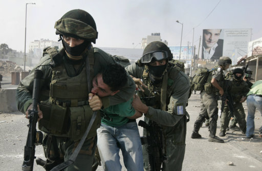 Israeli border police officers detain a Palestinian protester during clashes at the Qalandia checkpoint between the West Bank city of Ramallah and Jerusalem, Wednesday, Sept. 21, 2011. Palestinians clashed with Israeli security forces in Qalandia Wednesday, as thousands of flag-waving Palestinians rallied in towns across the West Bank to show support for their president's bid to win U.N. recognition of a Palestinian state. (AP Photo/Majdi Mohammed)