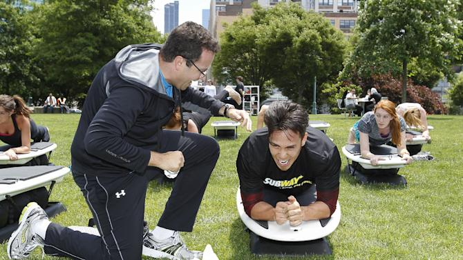 IMAGE DISTRIBUTED FOR SUBWAY -Subway's Jared encourages Olympic gold medalist Apolo Ohno during a work out to introduce the new limitededitionSUBWAY bag to encourage healthier lifestyles at Clinton Cove in New York on Wednesday June 12, 2013. (Photo by Mark Von Holden/ Invision for Subway/AP Images)