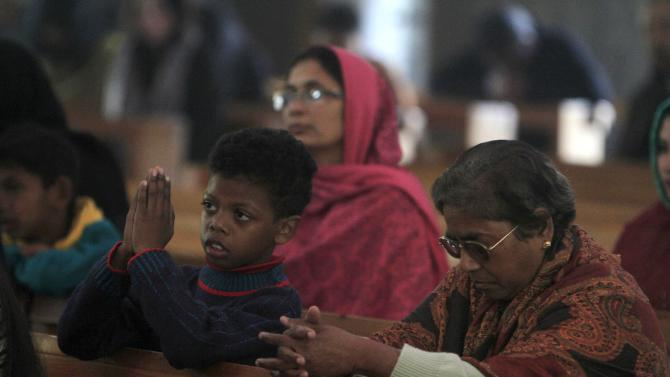 People attend a mass on Christmas day at Fatima Church in Islamabad
