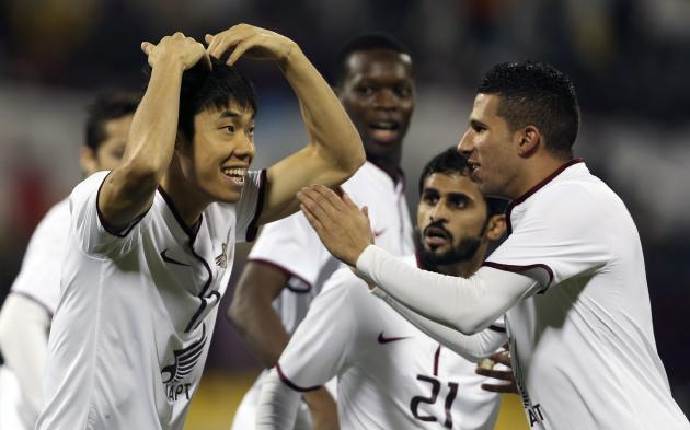 Qatar ElJaish's Ko celebrates with teammates after scoring a goal against Nasaf of Uzbekistan during their AFC Championship League match in Doha