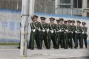 Paramilitary police officers patrol near the U.S. embassy in Beijing