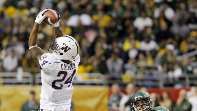 Washington's Jesse Callier makes a reception in front of Baylor's Sam Holl during the first half of the Alamo Bowl college football game, Thursday, Dec. 29, 2011, at the Alamodome in San Antonio. (AP Photo/Darren Abate)