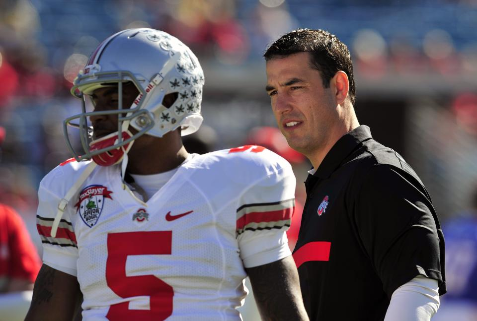 Ohio State head coach Luke Fickell watches his team warm up before the Gator Bowl NCAA college football game against Florida, Monday, Jan. 2, 2012, in Jacksonville, Fla. (AP Photo/Stephen Morton)