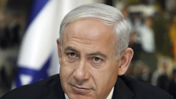 FILE - In this Thursday, Nov. 22, 2012 file photo, Israeli Prime Minister Benjamin Netanyahu visits the national police headquarters in Jerusalem. Netanyahu, who appeared to be cruising to victory a few weeks ago, suddenly appears vulnerable as national elections approach. His Likud Party's selection of an exceptionally hard-line slate of candidates, coupled with the political return of a popular former foreign minister could galvanize Israel's divided opposition.(AP Photo/Gali Tibbon, Pool, File)