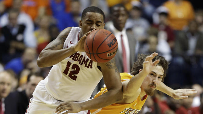 Alabama guard Trevor Releford (12) moves the ball against Tennessee forward Rob Murphy (15) during the second half of an NCAA college basketball game at the Southeastern Conference tournament on Friday, March 15, 2013, in Nashville, Tenn. (AP Photo/John Bazemore)