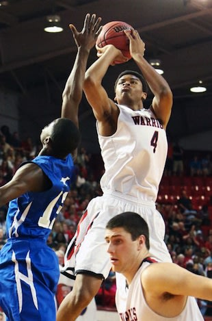 Isaiah Hicks' 34 points and 30 rebounds helped earn a state title — Johnny Johnson/News & Observer