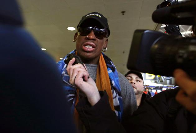 Former NBA basketball player Rodman talks to the media at the Beijing International Airport in Beijing