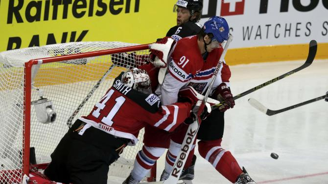 Erat of the Czech Republic crashes into the net of Canada's goaltender Smith during their Ice Hockey World Championship game at the O2 arena in Prague
