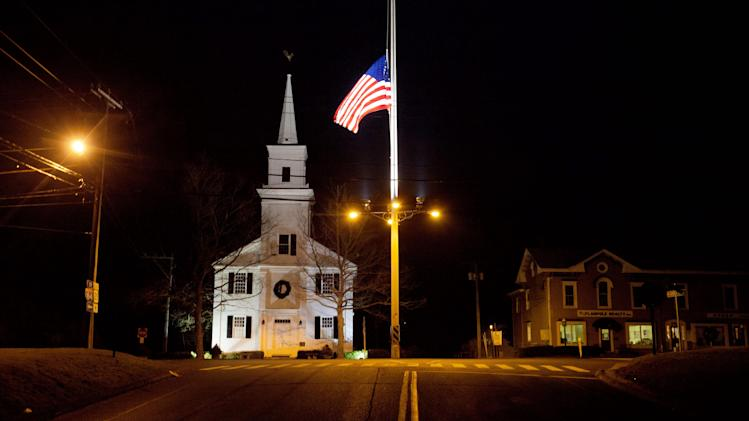 FILE - In this Dec. 15, 2012 file photo, a U.S. flag flies at half-staff on Main Street in honor of the 26 people killed when gunman Adam Lanza opened fire inside a Sandy Hook Elementary School on Dec. 14, 2012, in Newtown. (AP Photo/David Goldman, File)