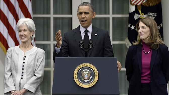 """FILE - This April 11, 2014 file photo shows President Barack Obama, flanked by outgoing Health and Human Services Secretary Kathleen Sebelius, left, and his nominee to replace her, current Budget Director Sylvia Mathews Burwell, speaking in the Rose Garden of the White House in Washington. There's a new health insurance term in the glossary, and it could mean thousands of dollars out of your pocket. It's a cost-control strategy called """"reference pricing."""" It puts a hard dollar limit on what health plans pay for certain expensive procedures _ like knee and hip replacements. The Obama administration has given the go-ahead for insurers and employers to use the approach, setting aside some legal concerns. (AP Photo/Susan Walsh, File)"""
