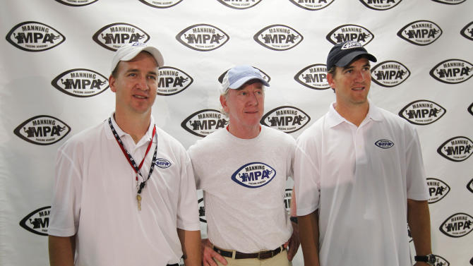 Archie Manning, center, poses with his sons Eli Manning, right, and Peyton Manning during a news conference at the Manning Passing Academy at Nicholls State University in Thibodaux, La., Friday, July 8, 2011. (AP Photo/Gerald Herbert)