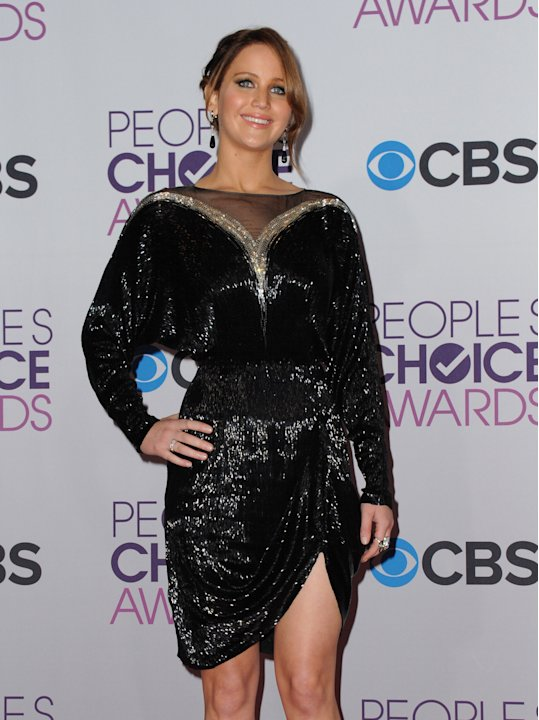 Jennifer Lawrence, winner of the award for favorite movie actress, poses backstage at the People's Choice Awards at the Nokia Theatre on Wednesday Jan. 9, 2013, in Los Angeles. (Photo by Jordan Straus