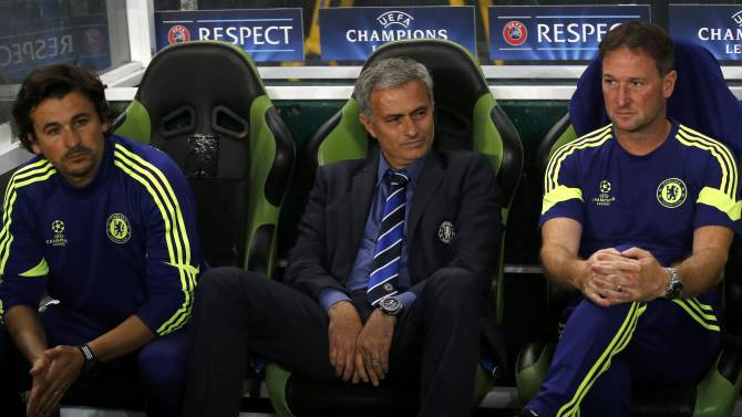 Chelsea?s coach Mourinho sits in the dugout before the kick off of their Champions League Group G soccer match against Sporting Lisbon at the Estadio Jose Alvade in Lisbon