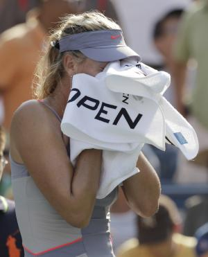 Maria Sharapova of Russia reacts after her match against Flavia Pennetta of Italy during the U.S. Open tennis tournament in New York, Friday, Sept. 2, 2011. (AP Photo/Charlie Riedel)