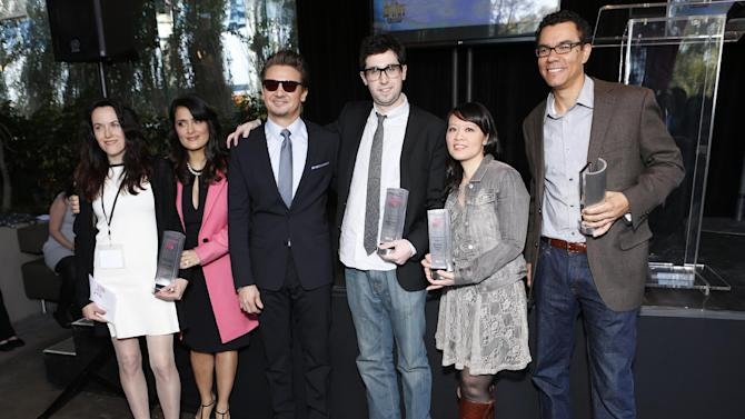 Jeremy Renner and Salma Hayek pose with award winners at the Film Independent Spirit Awards Luncheon at BOA Steakhouse on Saturday, Jan. 12, 2013, in West Hollywood, Calif. (Photo by Todd Williamson/Invision/AP)