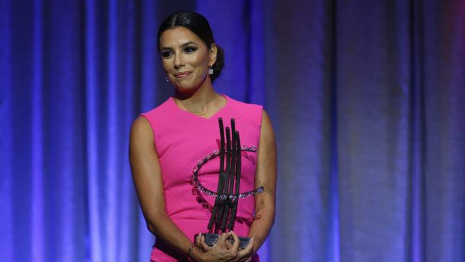 Presenter and actress Eva Longoria holds an award during the Clinton Global Citizens awards ceremony for the Clinton Global Initiative 2014 in New York