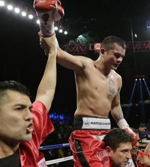 Marcos Rene Maidana, right, celebrates his win over Adrien Broner in an WBA welterweight title bout, Saturday, Dec. 14, 2013, in San Antonio. (AP Photo/Eric Gay)