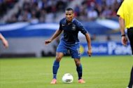 Malouda wary of threat posed by Chelsea team-mate Torres