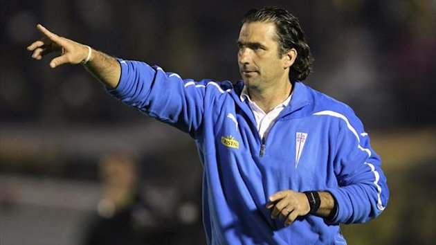 Chile's Universidad Catolica head coach Juan Antonio Pizzi gestures during their first leg quarter-finals Copa Libertadores match against Uruguay's Penarol in Montevideo (Reuters)