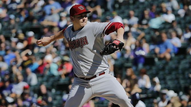 Arizona Diamondbacks starting pitcher Trevor Cahill throws to the plate against the Colorado Rockies during the first inning of a baseball game Saturday, Sept. 20, 2014, in Denver. (AP Photo/Jack Dempsey)