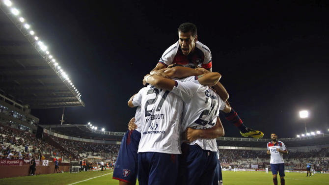 Romero of Paraguay's Cerro Porteno is embraced by teammates after he scored a goal against Argentina's Lanus in their Copa Sudamericana soccer match in Buenos Aires