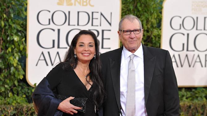 Ed O'Neill, right, and Catherine Rusoff arrive at the 70th Annual Golden Globe Awards at the Beverly Hilton Hotel on Sunday Jan. 13, 2013, in Beverly Hills, Calif. (Photo by John Shearer/Invision/AP)