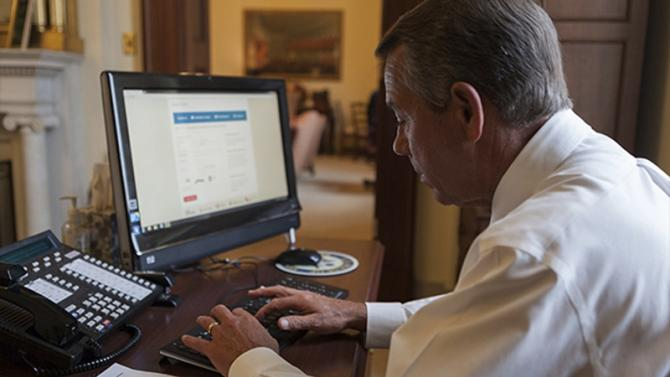 House Speaker John Boehner attempts to sign up for healthcare on the DC Health Link in Washington