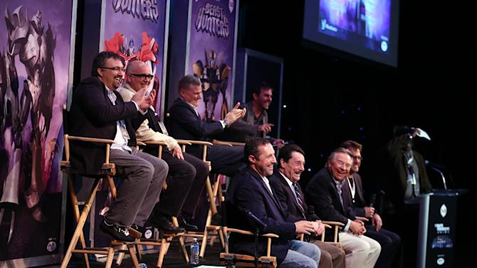 "IMAGE DISTRIBUTED FOR THE HUB - Panelists speak at The Hub's ""Transformers Prime Beast Hunters"" World Premiere Screening Event on Thursday, March 14, 2013 in Universal City, Calf. The panelists include, top row from left, David Hartman, supervising director/art producer, Duane Capizzi, co-executive producer, Stephen Davis, Hasbro Studios president, Robert Orci, executive producer, and bottom row from left, Jeff Kline, executive producer, Peter Cullen, voice of Optimus Prime, Frank Welker, voice of Megatron, and Steve Blum, voice of Starscream. (Photo by Matt Sayles/Invision for The Hub/AP Images)"