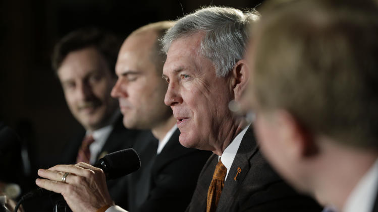 Texas coach Mack Brown, center, and Oregon coach Mark Helfrich, second from left, take part in a Valero Alamo Bowl news conference, Thursday, Dec. 12, 2013, in San Antonio. Texas and Oregon will play in the NCAA college football game Dec. 30. (AP Photo/Eric Gay)