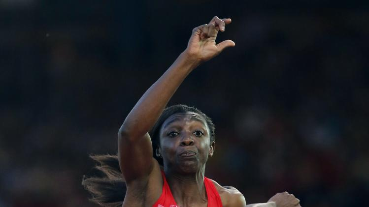 Cameroon's Mbumi Nkouindjin compete's in the women's Triple Jump qualifications at the 2014 Commonwealth Games in Glasgow, Scotland