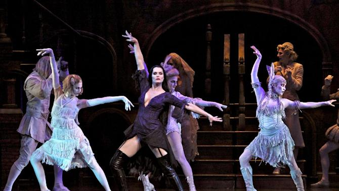 "In this theater image released by The Publicity Office, Brooke Shields portrays Morticia Addams, center, in a performance of ""The Addams Family,"" in New York. The production will end its run on Dec. 31, 2011. (AP Photo/The Publicity Office, Jeremy Daniel)"