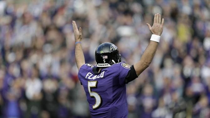 Baltimore Ravens quarterback Joe Flacco celebrates a touchdown during the first half of an NFL wild card playoff football game against the Indianapolis Colts Sunday, Jan. 6, 2013, in Baltimore. (AP Photo/Patrick Semansky)