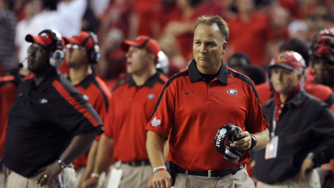 Georgia coach Mark Richt walks the sidelines in the first half of an NCAA football game against Boise State on Saturday, Sept. 3, 2011 at the Georgia Dome in Atlanta.   (AP Photo/David Tulis)