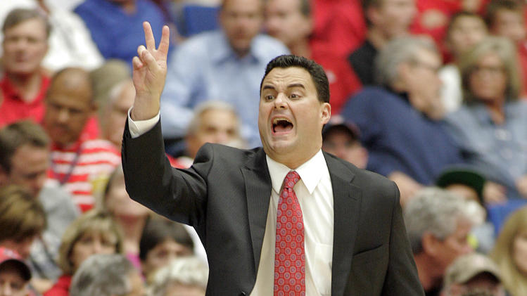 Arizona coach Sean Miller signals to his players during the first half of an NCAA college basketball game against Long Beach State in Tucson, Ariz., Monday, Nov. 19, 2012. (AP Photo/John Miller)