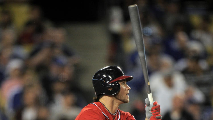 Washington Nationals' Bryce Harper hits an RBI sacrifice fly during the ninth inning of their baseball game against the Los Angeles Dodgers, Saturday, April 28, 2012, in Los Angeles. (AP Photo/Mark J. Terrill)