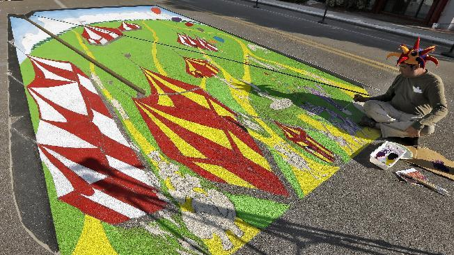 Anthony Cappetto, of New York, NY., works on his 3D pavement art project during the Sarasota Chalk Festival Wednesday, Oct. 31, 2012, in Sarasota, Fla. The annual festival begins this week and runs through Nov. 6.(AP Photo/Chris O'Meara)