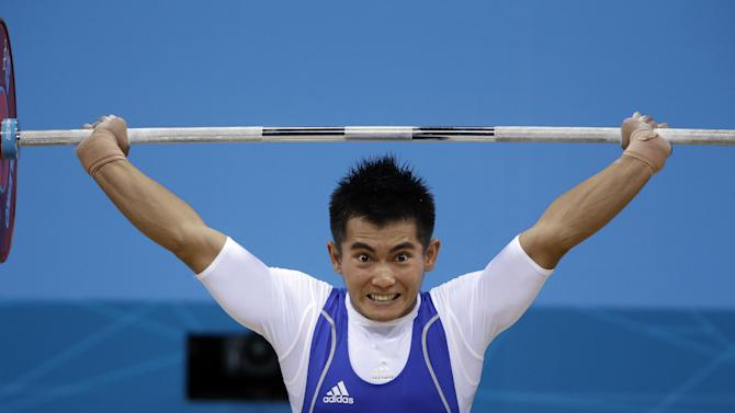 Muhamad Hasabi of Indonesia competes during the mens 62-kg weightlifting competition at the 2012 Summer Olympics, Monday, July 30, 2012, in London. (AP Photo/Mike Groll)